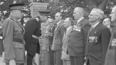 Sir Edmund Bacon speaks to guests at the Second World War Memorial Bungalows on Mousehold Lane, Norwich 1951