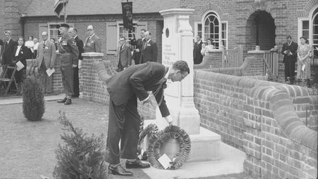 Lord Mayor of Norwich Eric Hinde lays a wreath at the Second World War Memorial bungalows on Mousehold Lane, Norwich in 1951