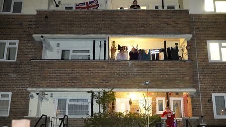 People applaud the NHS from their balconies and gardens across the road from Wythenshawe Hospital, M