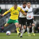 Graeme Shinnie of Derby County and Emiliano Buendia of Norwich in action during the Sky Bet Champion