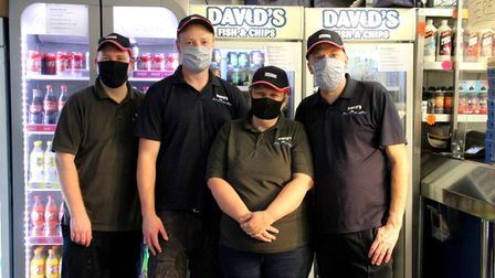 The team from David's stand together smiling through Covid safety masks.