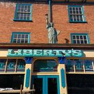 Liberty's Bar with a new statue of liberty at the top.