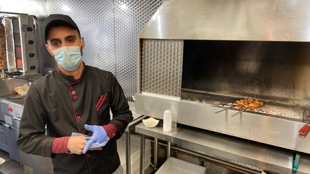 Azad Ali, an employee at Great Yarmouth Shawarma, cooking chicken.