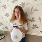 Kyla Dixon in Upminster holding Little Princess Trust balloon