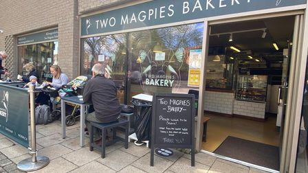 People enjoying lunch at Two Magpies Bakery on Norwich's Timberhill.