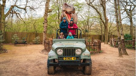 A family with the T-Rex at World of Dinosaurs at Paradise Wildlife Park.