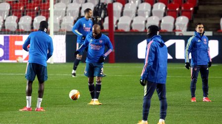 Arsenal's Alexandre Lacazette (centre) and team-mates warm up before the UEFA Europa League match at