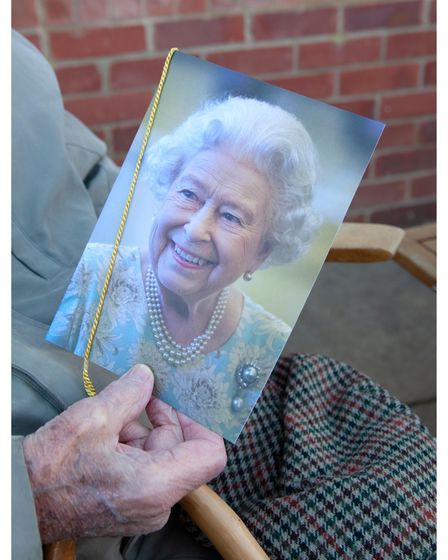Arthur Squires receives his card from The Queen on his 100th birthday.
