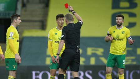 Dimitris Giannoulis of Norwich is sent off by Referee Graham Scott for a foul on Ben Pearson of Bour