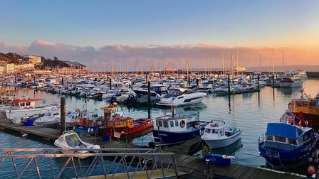 Torquay harbour at sunset.