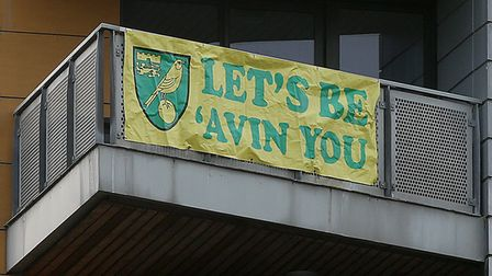 A banner on the flats outside Norwich City's stadium ahead of Bournemouth's visit