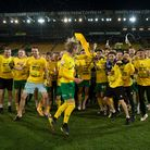 The Norwich players and backroom staff celebrate promotion back to the Premier League at the end of