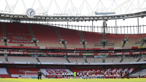 Arsenal players stand for a minute's silence in memory of the Duke of Edinburgh at the Emirates Stadium