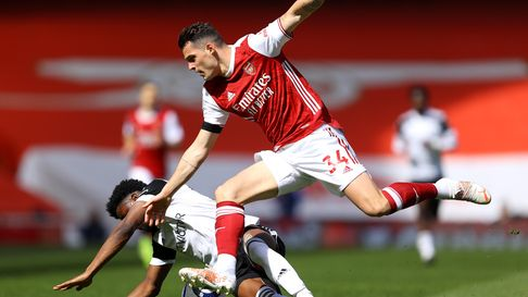 Fulham's Josh Maja and Arsenal's Granit Xhaka battle for the ball
