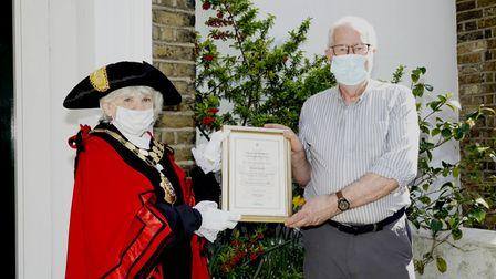 Mark Austin being presented his civic award by mayor Cllr Janet Burgess