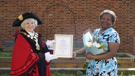Rosalyn Tyrell, known as Rose, 80,being presented her civic award by mayor Cllr Janet Burgess