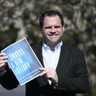 EMBARGOED TO 0001 SUNDAY APRIL 18 Fine Gael TD Neal Richmond with his plan for United Ireland at hom