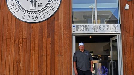 Owner Mick Cox standing outside Cox's at the Lighthouse Fish and Chip shop.