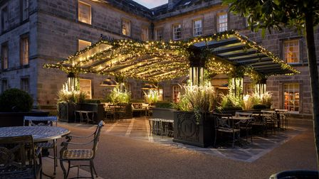 The luxurious Norton Courtyard at Grantley Hall sparkles at nightwith fairy lights
