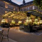 The luxurious Norton Courtyard at Grantley Hall sparkles at night with fairy lights