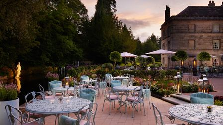 Norton Courtyard - floral chairs and fire pits outside in a country garden