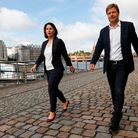 Co-leaders of Germany's Green party Annalena Baerbock (L) and Robert Habeck walk along the river Spr