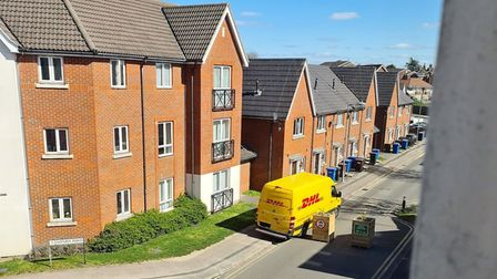 A DHL delivery van appears to drive around planters designed to close Jovian Way, Ipswich to traffic