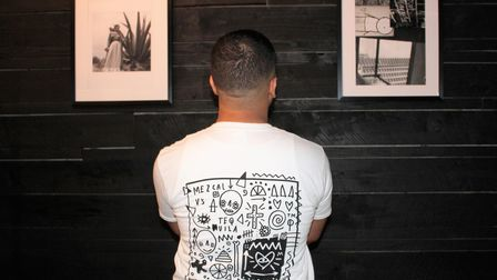 Skeleton Cardboard's uniform designstap into both Caldera and the artist's focus on Mexican-influenced themes and culture.