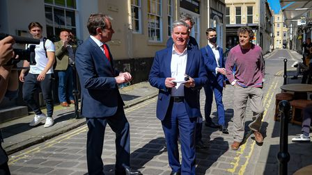 Labour leader Sir Keir Starmer (centre) turns away from Rod Humphris (right), landlord of The Raven pub in Bath