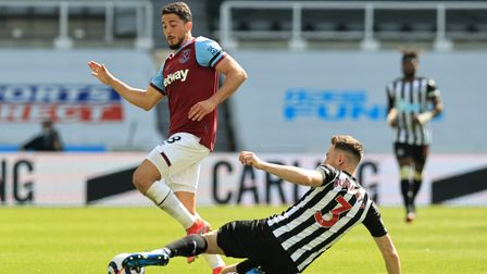 West Ham United's Pablo Fornals is tackled by Newcastle United's Paul Dummett at St James' Park
