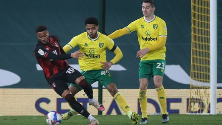 Arnaut Danjuma of Bournemouth and Andrew Omobamidele of Norwich in action during the Sky Bet Champio
