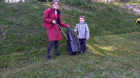 Carol Stanier from Royston out wombling with son Matthew