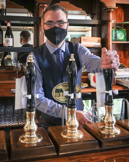 David Briggs brings his barman expertise to use on the first day The Railway pub in Saffron Walden opens it's doors as