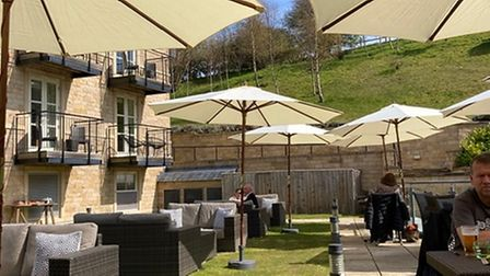 The sheltered and welcoming outdoor restaurant at Raithwaite Sandsend with umbrellas and sofas