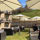 The sheltered and welcoming outdoor restaurant at Raithwaite Sandsendwith umbrellas and sofas