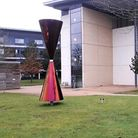 Diane Maclean'sDiabolo coloured stainless steel sculpture at the University of Hertfordshire.