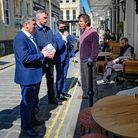 Labour leader Sir Keir Starmer (left) listens to Rod Humphris (centre), landlord of The Raven pub in