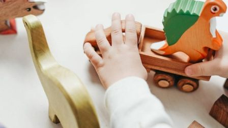 Child playing with wooden toys as Stevenage Cheeky Cherubs Baby and Toddler Group announces closure