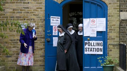 Nuns leave a polling station after voting in London on May 7, 2015