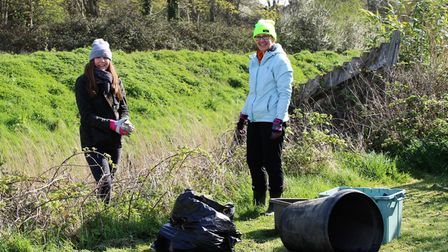 The 'magnificent seven' volunteers clearingbags of rubbish between the two bridges in Brampton Way.