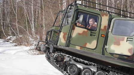 Vladimir Putinbehind the wheel of an all-terrain vehicle while driving through a taiga forest in Siberia, in March 2021