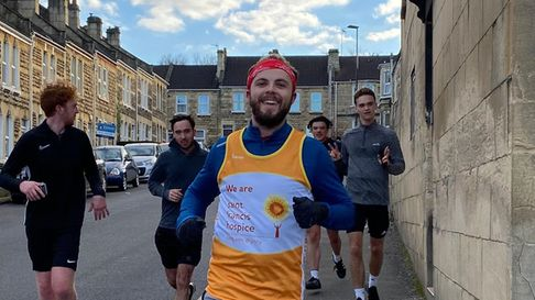 A smiling Zack on the run with his friends for support