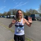 Ilford AC's Terry Knightley with his Essex Half Marathon medal.