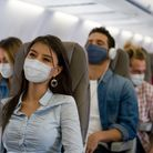 Portrait of a Latin American Woman traveling by plane wearing a facemask during the COVID-19 pandemi