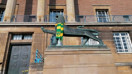 Norwich City Council's lions are sporting Canaries scarves to mark the club's promotion to the Premier League
