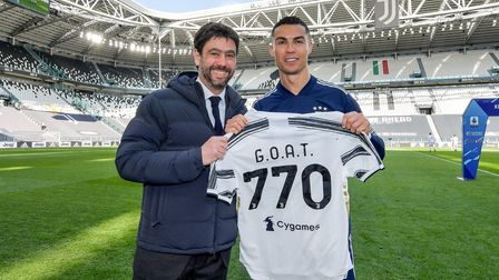 Juventus' president Andrea Agnelli with Cristiano Ronaldo and a shirt to celebrate 770 goals scored in his career
