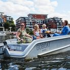 people in a motor boat on the River Thames