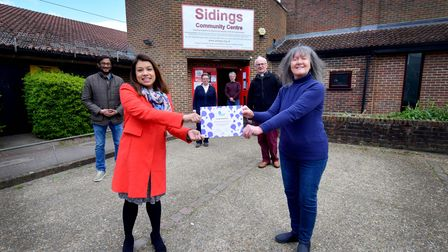 Tulip Siddiq MP presents Sue Measures and volunteers at Siding Community Centre NW6 with a certificate