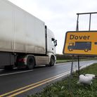 A lorry passes a Dover sign as it makes it's way into the lorry park at Manston Airport, Kent, after
