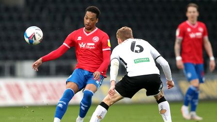 Queens Park Rangers' Chris Willock (left) and Swansea City's Jay Fulton battle for the ball